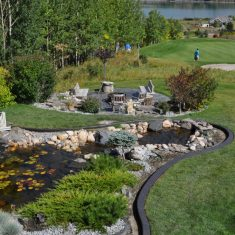 A custom landscaping project within Calgary. Big Pond and curb appeal on Golf Course