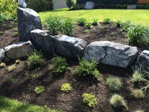 artificial grass and landscape design rock arrangement