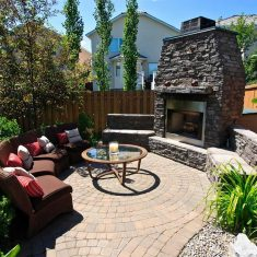 Backyard concrete curbing and retaining wall with fireplace