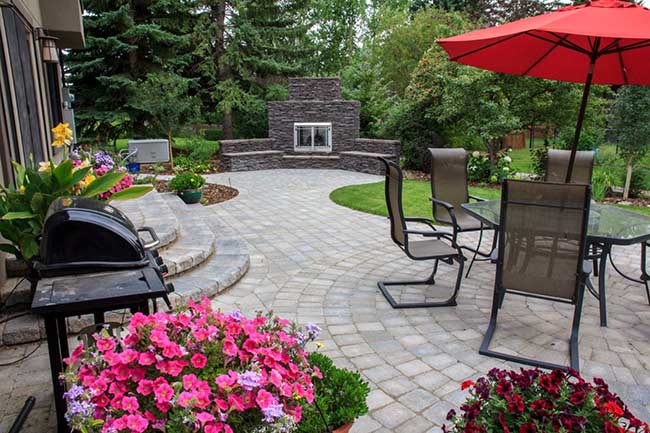 Backyard Curb appeal with outdoor fireplace with a bit of artificial grass