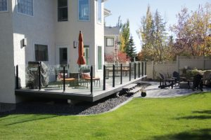 backyard landscape design concrete curbing and outdoor fireplace