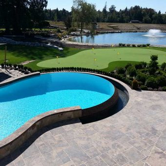 Beautiful custom-built pool or spa. Right next to a putting green on a gold course.