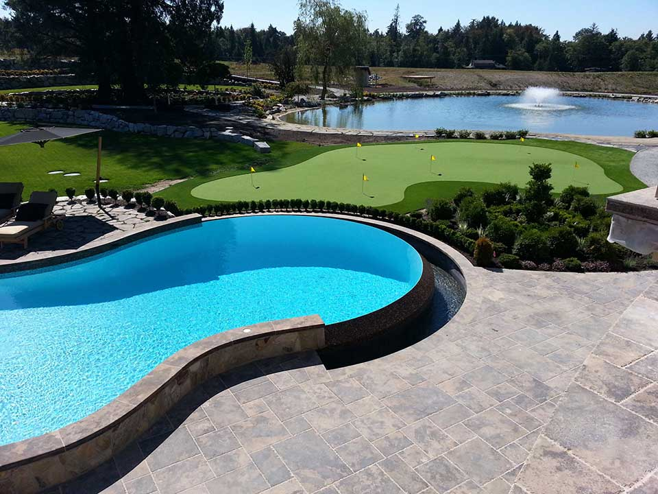 Beautiful custom built pool or spa right next to a for Pool design course