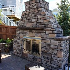 Calgary landscape with exclusive fireplace with riverstone