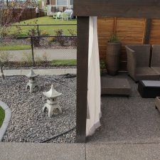 concrete curbing and walkway with outdoor patio