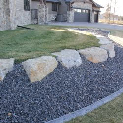 Concrete Curbing or Curb Appeal used on a Calgary Landscape with big landscape rocks.