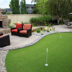 Concrete Curbing used to separate artificial grass putting green.