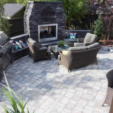 Custom large landscape in Calgary with Fireplace