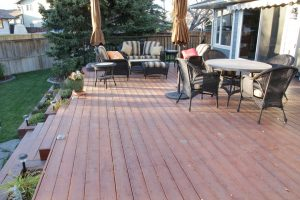 deck and concrete curbing landscaping