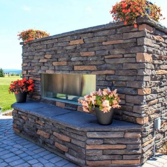 Fireplace retaining wall with flowers