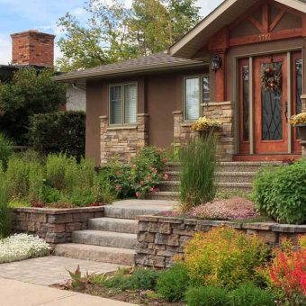 Front yard with no lawn. Stunning retaining walls with walkway and steps.