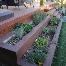 landscape arrangement on deck staircase