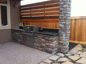 outdoor kitchen with cedar backboard
