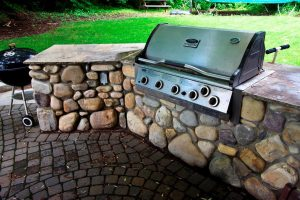 Outdoor kitchen with river-stone and granite counter-tops