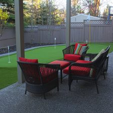 putting green with mini patio and concrete curbing