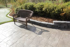 retaining wall with concrete curbing and putting green artificial grass
