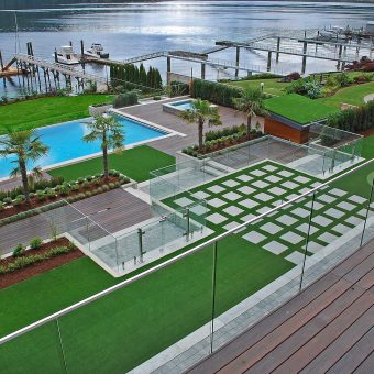 Stunning view of a custom landscaping project on a lake