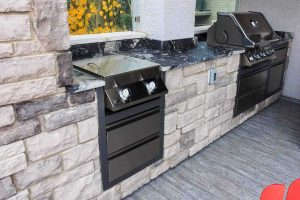 Unique outdoor kitchen with high quality granite counter-tops