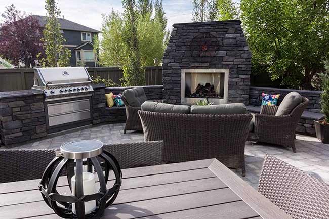 Backyard kitchen and fireplace